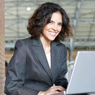 Picture of businesswoman using a laptop computer.